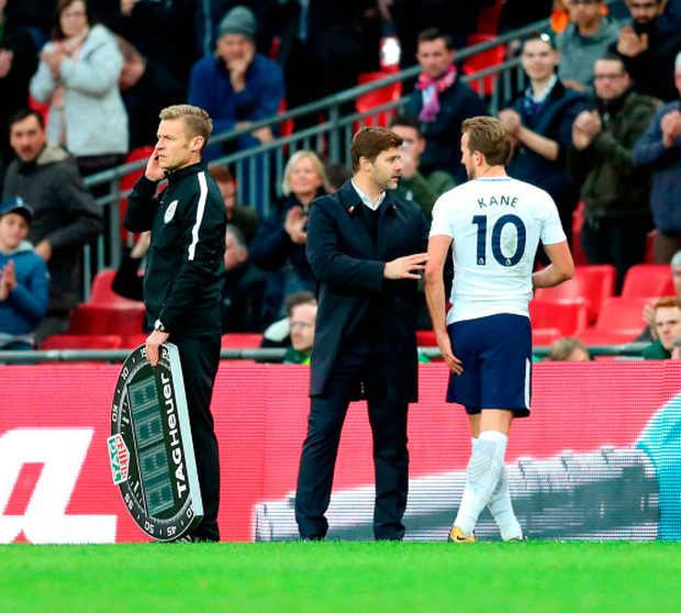 Tottenham striker Harry Kane clutches his hamstring after being substituted by manager Mauricio Pochettino in last Sunday's Premier League win over Liverpool at Wembley. Photo: PA Wire
