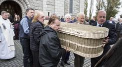 Eddie Furey, Seán Cannon and Paddy Reilly help to carry the remains of Dubliner Eamonn Campbell from St Agnes Church, Crumlin Photo: Kyran O'Brien and Colin Keegan