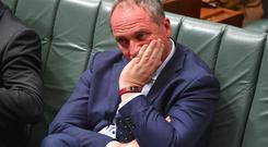 Australian Deputy Prime Minister Barnaby Joyce reacts as he sits in the House of Representatives at Parliament House in Canberra, Australia, October 25, 2017. AAP/Mick Tsikas/via REUTERS