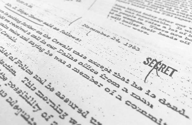 Part of a file, dated Nov. 24, 1963, quoting FBI director J. Edgar Hoover as he talks about the death of Lee Harvey Oswald, released for the first time on Thursday, Oct. 26, 2017 (AP Photo/Jon Elswick)
