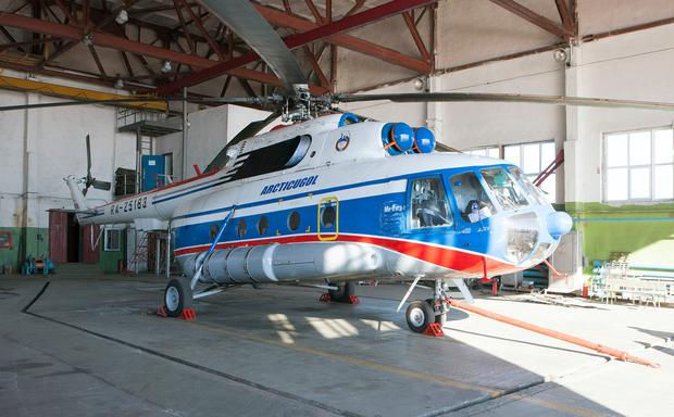 FILE - A May 5, 2011 file photo of the Russian helicopter in the hanger of the Russian helicopter base at Kapp Heer, Barentsburg, Svalbard which has fallen into the sea off Svalbard, an Arctic archipelago that belongs to Norway, with eight people on board. The rescue service for northern Norway says the helicopter was en route to Barentsburg, Svalbard's second largest settlement, from the Russian settlement of Pyramiden. (Birger Amundsen/NTB scanpix via AP)