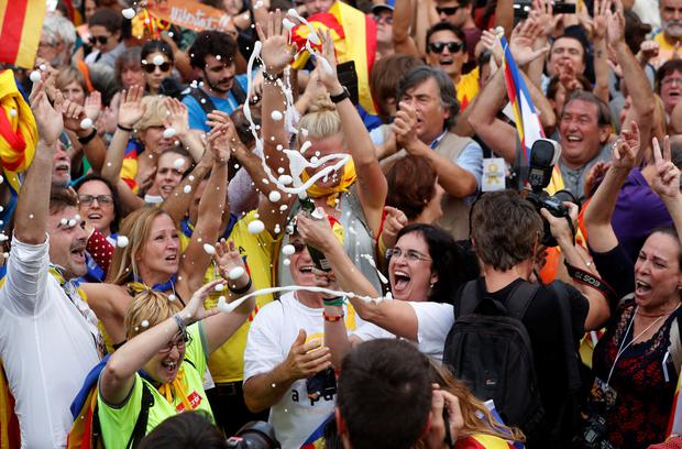 People celebrate after the Catalan regional parliament passes the vote of independence from Spain in Barcelona. Photo: Reuters