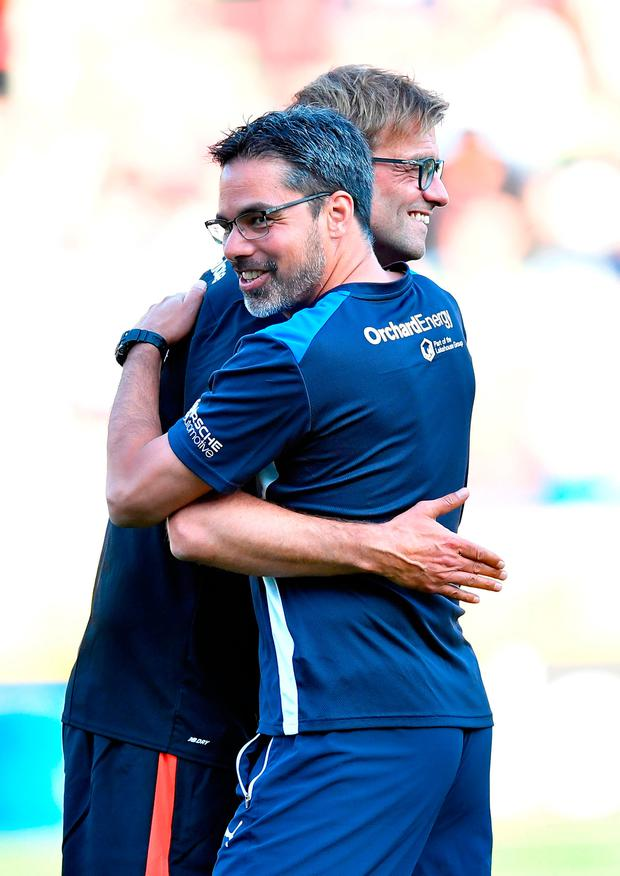 Jurgen Klopp and David Wagner square off today. Photo credit: Dave Howarth/PA Wire