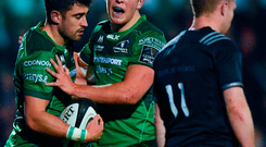 Tiernan O'Halloran of Connacht celebrates with team-mate Tom Farrell, right, after scoring his side's first try