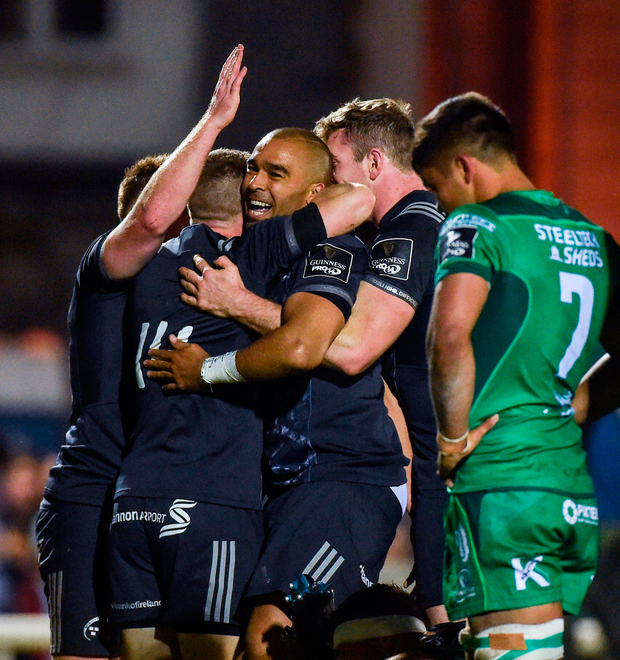 Simon Zebo of Munster celebrates with team-mates after scoring his side's first try