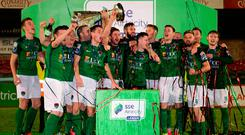 Cork City players celebrate with the SSE Airtricity League Premier Division trophy