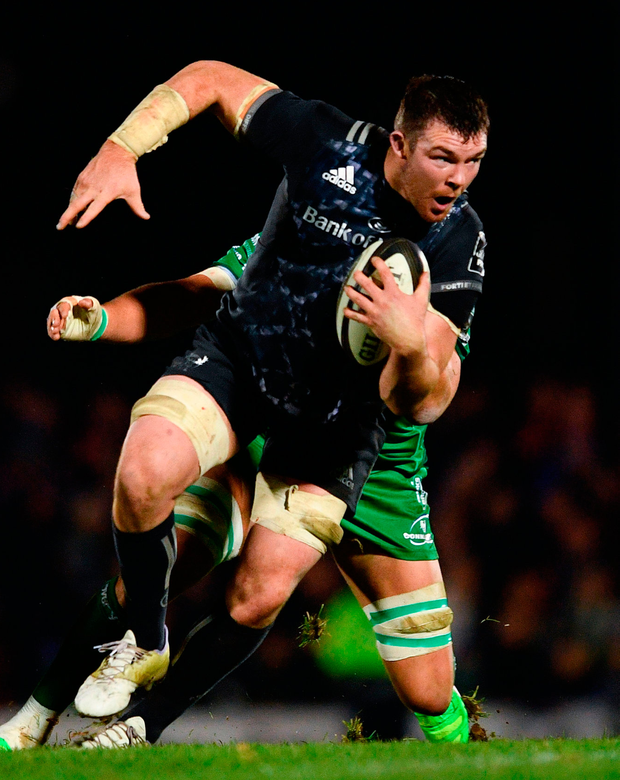Munster's Peter O'Mahony is tackled by Quinn Roux of Connacht during the match. Photo: Ramsey Cardy/Sportsfile