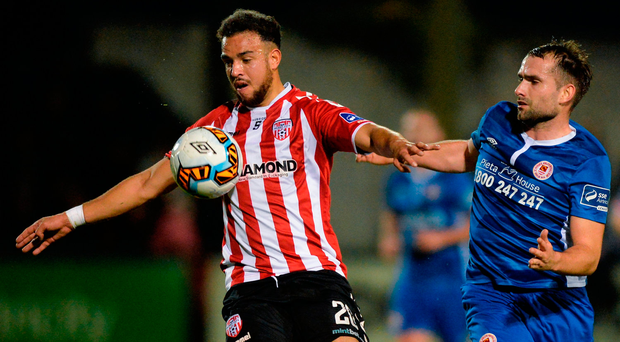 Darren Cole of Derry City in action against Christy Fagan of St Patrick's Athletic. Photo by Oliver McVeigh/Sportsfile