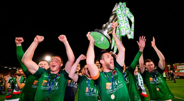 Cork players celebrate the title last year. Photo by Seb Daly/Sportsfile