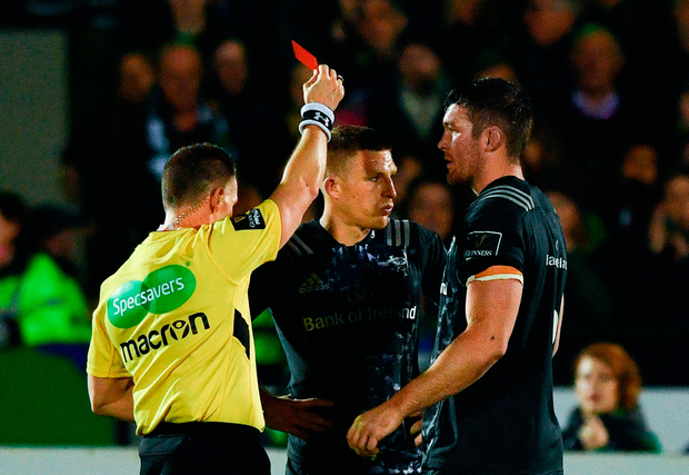 Munster's Andrew Conway, centre, receives a red card from referee Nigel Owens during their defeat to Connacht at the Sportsground in Galway last night. Photo by Ramsey Cardy/Sportsfile