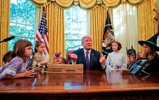 President Donald Trump meets with children dressed in their Halloween costumes in the Oval Office of the White House, Friday, Oct. 27, 2017.(AP Photo/Pablo Martinez Monsivais)