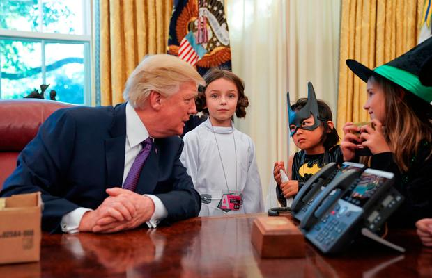 President Donald Trump talks with from left., Natalynn Parkinson, 6, Yume Inone, 6, and Phoebe Trabb, 7, who are dressed in their Halloween costumes in the Oval Office of the White House, Friday, Oct. 27, 2017. (AP Photo/Pablo Martinez Monsivais)
