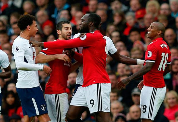 Manchester United's Romelu Lukaku and Ashley Young clash with Tottenham's Dele Alli while Manchester United's Henrikh Mkhitaryan looks on