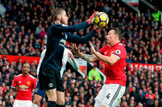 Manchester United goalkeeper David De Gea collides with Phil Jones