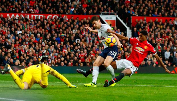 Tottenham's Ben Davies and Hugo Lloris in action with Manchester United's Marcus Rashford