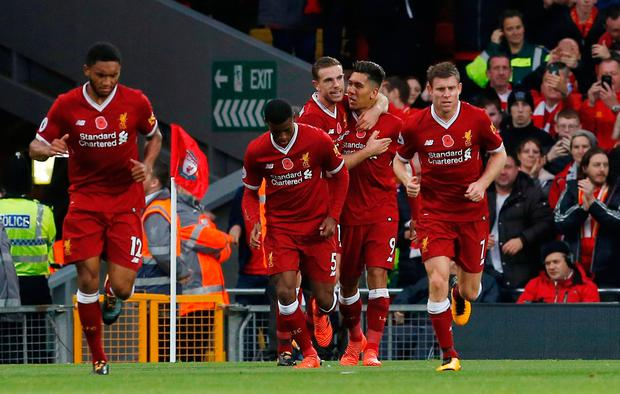 Liverpool's Roberto Firmino celebrates scoring their second goal with Jordan Henderson and team mates