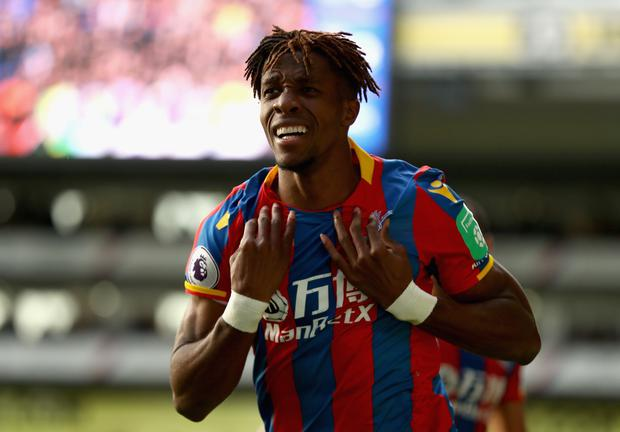 Wilfried Zaha of Crystal Palace celebrates scoring his sides second goal during the Premier League match between Crystal Palace and West Ham United at Selhurst Park on October 28, 2017 in London, England. (Photo by Bryn Lennon/Getty Images)