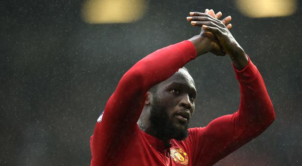 Manchester United's Belgian striker Romelu Lukaku applauds supporters after the English Premier League football match between Manchester United and Tottenham Hotspur at Old Trafford in Manchester, north west England, on October 28, 2017. Manchester United won the game 1-0. / AFP PHOTO / Oli SCARFF / RESTRICTED TO EDITORIAL USE. No use with unauthorized audio, video, data, fixture lists, club/league logos or 'live' services. Online in-match use limited to 75 images, no video emulation. No use in betting, games or single club/league/player publications. / (Photo credit should read OLI SCARFF/AFP/Getty Images)