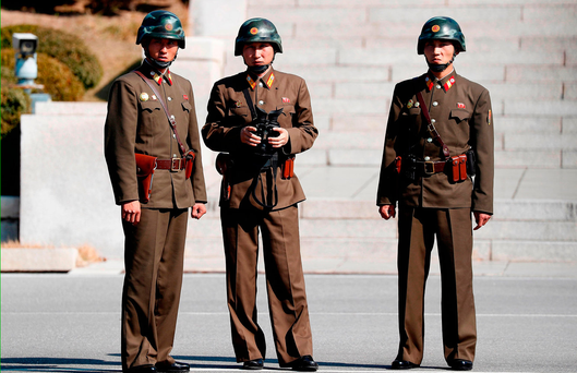 North Korean soldiers look at the South side while US Defence Secretary Jim Mattis and South Korean defence minister Song Young-moo visit the truce village of Panmunjom in the DMZ
