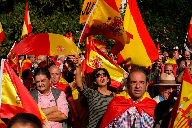 Demonstrators shout slogans and hold Spanish flags as they protest against the secession of Catalonia from Spain. Photo: Getty