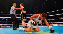 Katie Taylor is ushered to a neutral corner as she knocks down Anahi Sanchez during their WBA Lightweight World Championship contest at Principality Stadium on October 28, 2017 in Cardiff, Wales. (Photo by Richard Heathcote/Getty Images)