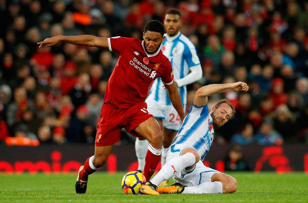 Liverpool's Joe Gomez in action with Huddersfield Town's Laurent Depoitre. Photo: Phil Noble/Reuters