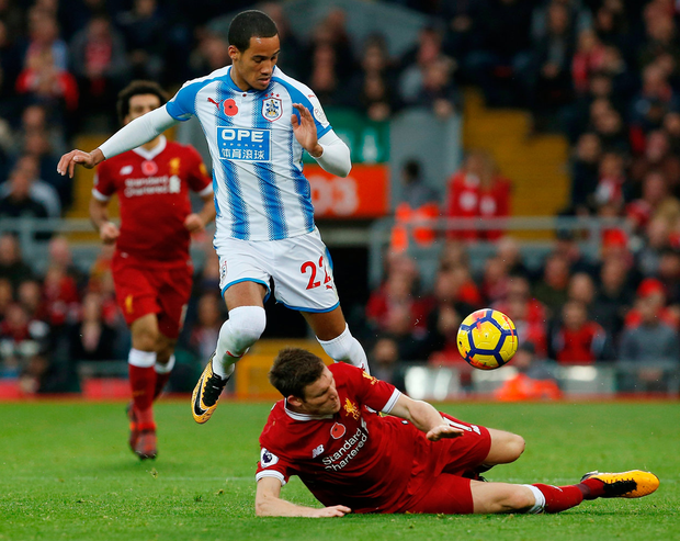 Liverpool's James Milner tackles Huddersfield Town's Tom Ince. Photo: Reuters/Craig Brough.
