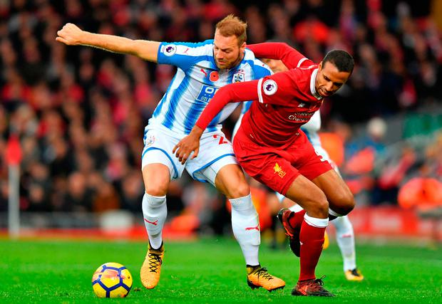 Huddersfield Town's Laurent Depoitre (left) and Liverpool's Joel Matip battle for the ball during the Premier League match at Anfield. Photo: Dave Howarth/PA