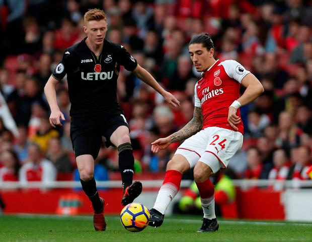 Arsenal's Hector Bellerin battles for the ball with Swansea City's Samuel Clucas. Photo: Paul Childs/Reuters