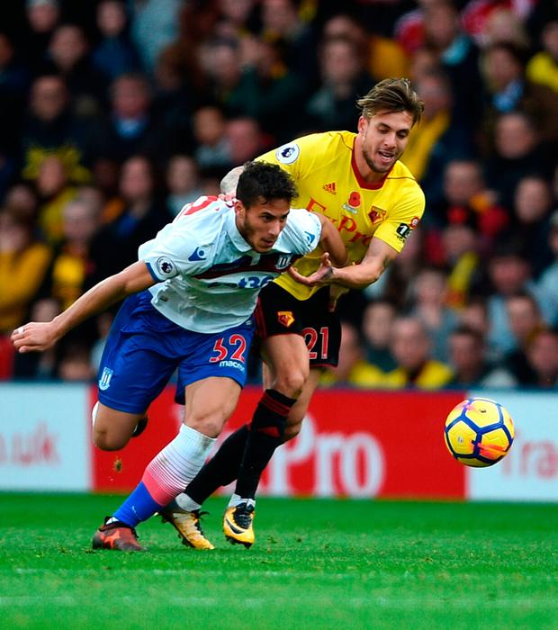 Stoke City's Ramadan Sobhi (left) and Watford's Kiko Femenia (right) battle for the ball during the Premier League match at Vicarage Road. Photo: Daniel Hambury/PA