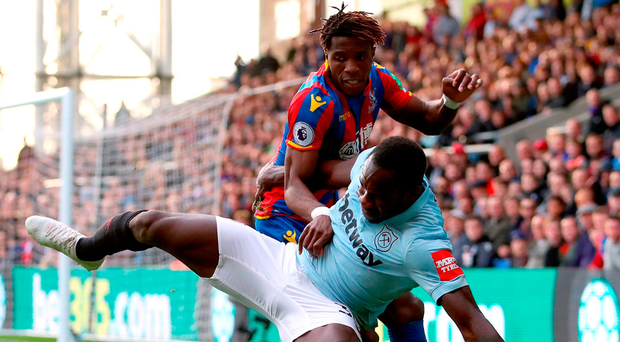 West Ham United's Michail Antonio (front) and Crystal Palace's Wilfried Zaha (back) battle for the ball during the Premier League match at Selhurst Park. Photo: John Walton/PA
