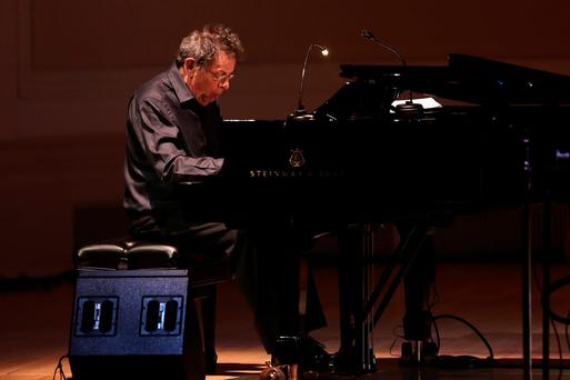 Musician Philip Glass performs on stage