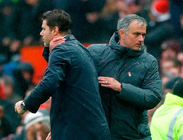 Manchester United manager Jose Mourinho (left) shakes hands with Tottenham Hotspur manager Mauricio Pochettino after the match. Photo: Martin Rickett/PA