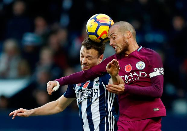 West Bromwich Albion's Jonny Evans battles for the ball with Manchester City's David Silva. Photo: Andrew Boyers/Reuters