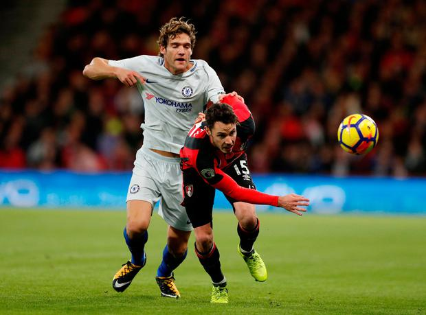 Bournemouth's Adam Smith battles with Chelsea's Marcos Alonso. Photo: John Sibley/Reuters