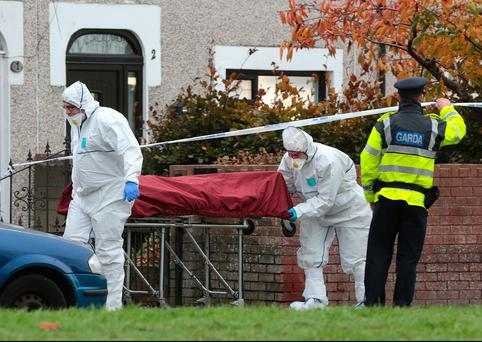The body is taken away from the scene of the shooting in Coolock, Dublin. Photo: David Conachy