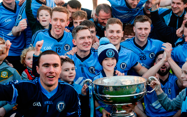 Simonstown Gaels players and supporters celebrate with the Keegan Cup