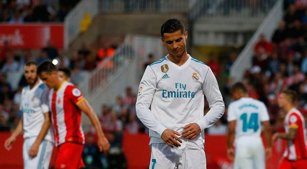 Real Madrid's Cristiano Ronaldo looks down after another attempt on goal during the La Liga match against Girona