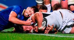 Sean Reidy of Ulster scoring his side's try despite the best efforts of Leinster's Ross Byrne. Photo by David Fitzgerald/Sportsfile