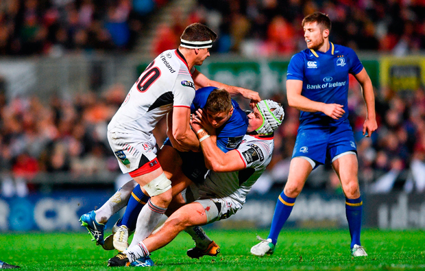 Jordan Larmour of Leinster is tackled by Robbie Diack, left, and Luke Marshall of Ulster. Photo by Ramsey Cardy/Sportsfile