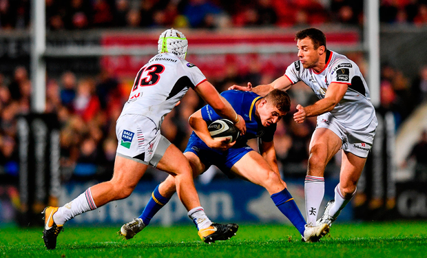Jordan Larmour of Leinster in action against Luke Marshall, left, and Tommy Bowe of Ulster. Photo by Ramsey Cardy/Sportsfile
