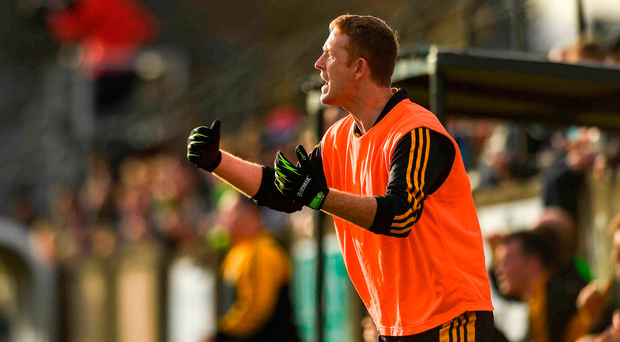 Colm Cooper reacts to a late score on the sidelines during his club Dr Crokes' Munster SFC quarter-final clash with Clonmel Commercials yesterday. Photo by Eóin Noonan/Sportsfile