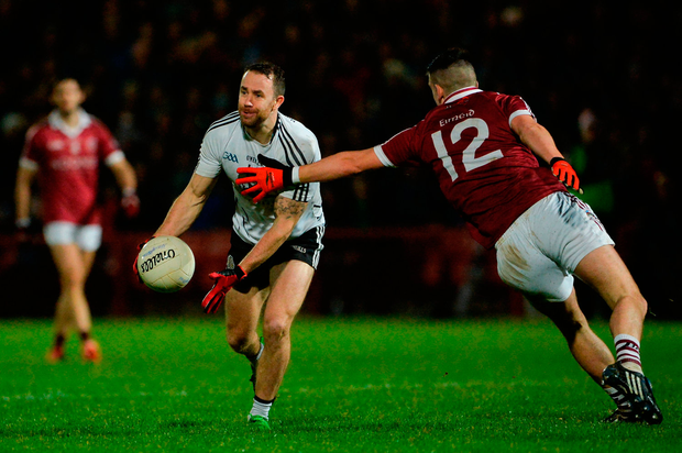 Conor O'Donnell of Omagh St Enda's in action against Meehaul McGrath of Slaughtneil. Photo by Oliver McVeigh/Sportsfile