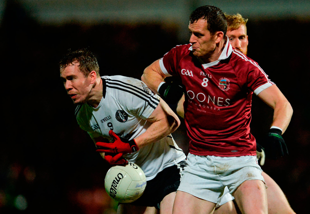 Michal Gallagher of Omagh St Enda's in action against Patsy Bradley of Slaughtneil. Photo by Oliver McVeigh/Sportsfile