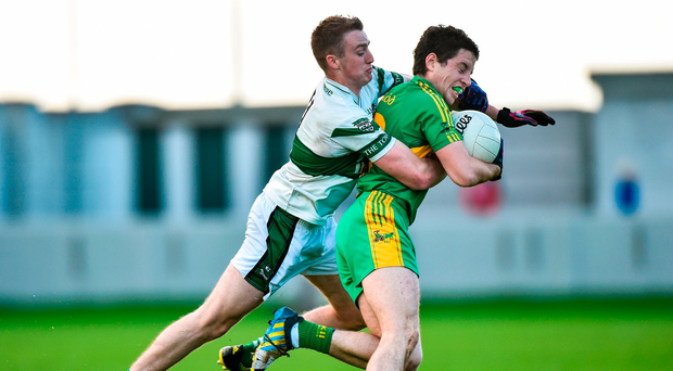 Rhode's James McPadden is tackled by Portlaoise's Benny Carroll at O'Connor Park, Tullamore, yesterday. Photo by Matt Browne/Sportsfile