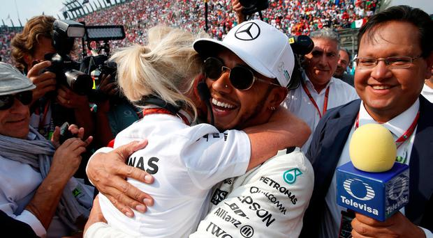 Mercedes' Lewis Hamilton celebrates after winning the World Championship