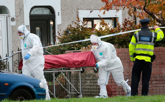 The body of Jamie Tighe is taken from the scene after he was shot in Coolock, Dublin. Photo: David Conachy