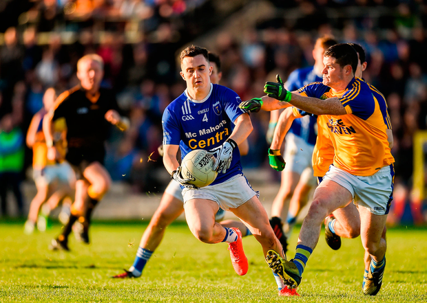 Sean Mohan of Scotstown in action against Pauric Carr of Kilcar. Photo by Philip Fitzpatrick/Sportsfile