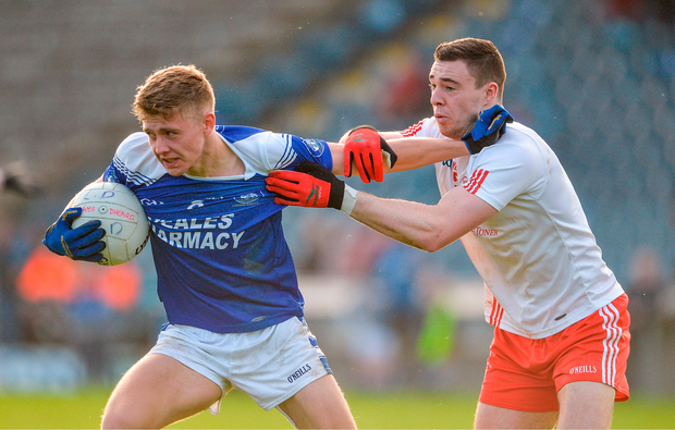 Paul Graham of Cavan Gaels in action against Declan Lynch of Lamh Dhearg. Photo by Oliver McVeigh/Sportsfile