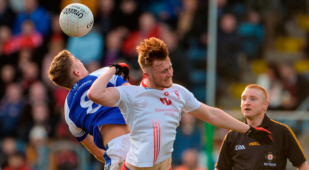 Paul Graham of Cavan Gaels in action against Pearse Fitzsimons of Lamh Dhearg. Photo by Oliver McVeigh/Sportsfile